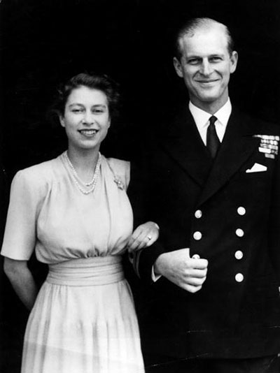10th July 1947: The first official picture after the announcement of the engagement of Princess Elizabeth and Lieutenant Philip Mountbatten, the former Prince Philip of Greece, at Buckingham Palace. The princess is wearing her enagement ring for the first time. (Photo by Hulton Archive/Getty Images)