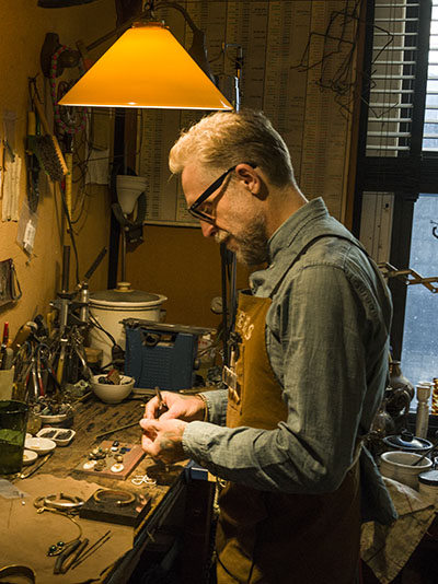 Philip Crangi at his work bench Photo by Sally Davies