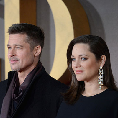 "LONDON, ENGLAND - NOVEMBER 21: Brad Pitt and Marion Cotillard attend the UK Premiere of ""Allied"" at Odeon Leicester Square on November 21, 2016 in London, England. (Photo by Dave J Hogan/Getty Images)"