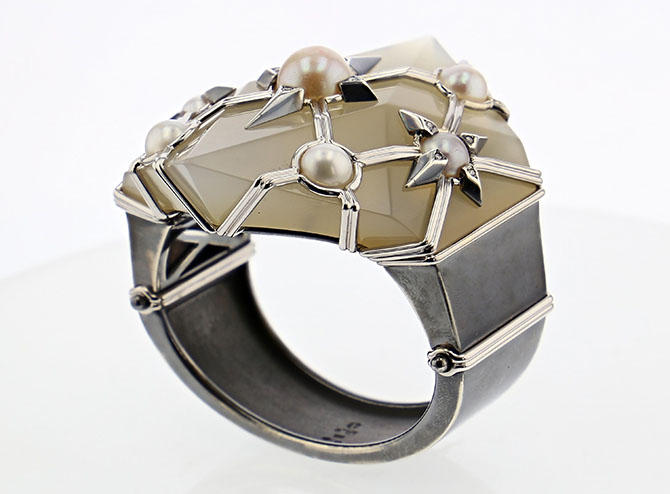Elie Top made a broken chalcedony Suzanne Belperron cuff wearable again for a client by adding elements from his Cosmogonie Secrète designs to the jewel including pearl, white gold, blackened silver and diamond stars. Photo courtesy