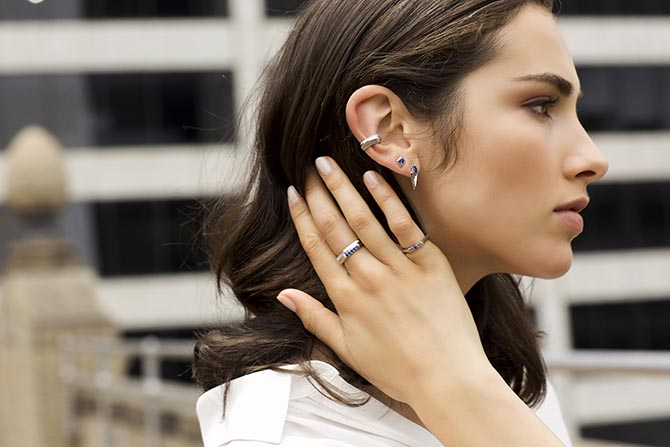 Model wearing several coordinated Valani 18K white gold jewels including an ear cuff Photo courtesy