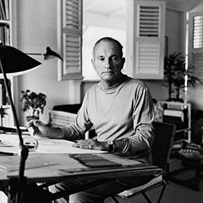 Jewelry designer Jean Schlumberger at his drawing board in one of several small houses that make up his living space at Bisdary on Guadeloupe. (Photo by Horst P. Horst/Condé Nast via Getty Images)