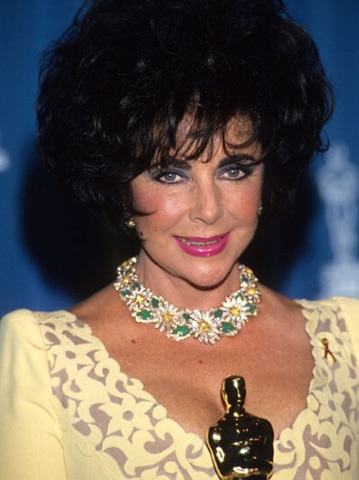 NEW YORK, NY - FEBRUARY 23: Elizabeth Taylor poses with her oscar at the 65th Annual Academy Awards at the Shrine Auditorium on March 29, 1993 in Los Angeles, California. (Photo by Kevin Mazur/WireImage)