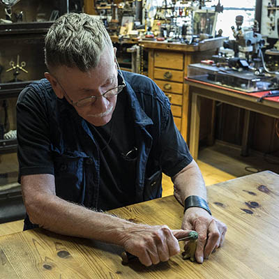 Cynthia Bach's husband, Jim Matthews, carving on a wax in his workshop located in the couple's Los Angeles home. Photo by Sally Davies