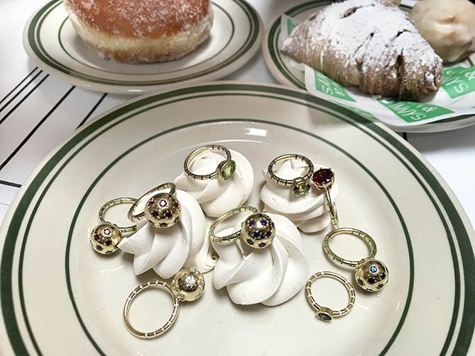 A selection of rings from Sarah Hendler's collection among the pastries at Jon & Vinny's restaurant in Los Angeles Photo by Sally Davies
