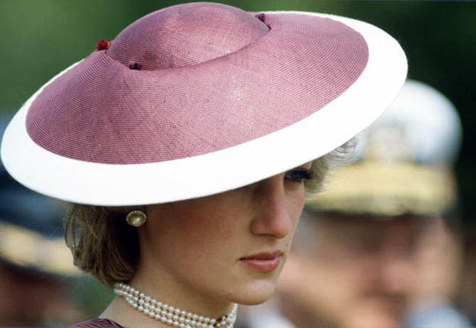 Princess Diana wearing her triple pearl choker with a hat by Frederick Fox during an April 1985 visit to Anzio, Italy.