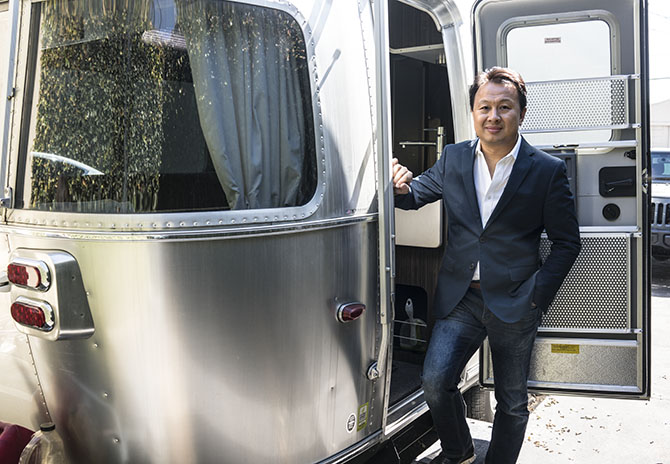 Christian Tse stepping out of the Airstream parked behind his studio facility where he has sent the night upon occasion when a creative session runs late into the evening. Photo by Sally Davies