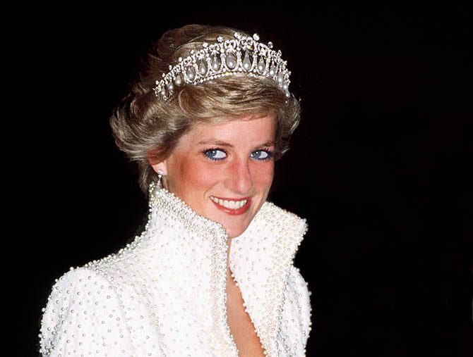 Princess Diana wearing the Cambridge Lover's Knot Tiara on a trip to Hong Kong in November, 1989 with an outfit by Catherine Walker often described as her Elvis ensemble. Photo by Tim Graham/Getty Images