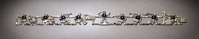 An American fancy cut diamond bracelet with sapphire accents depicting a jazz orchestra. Courtesy of Neil Lane