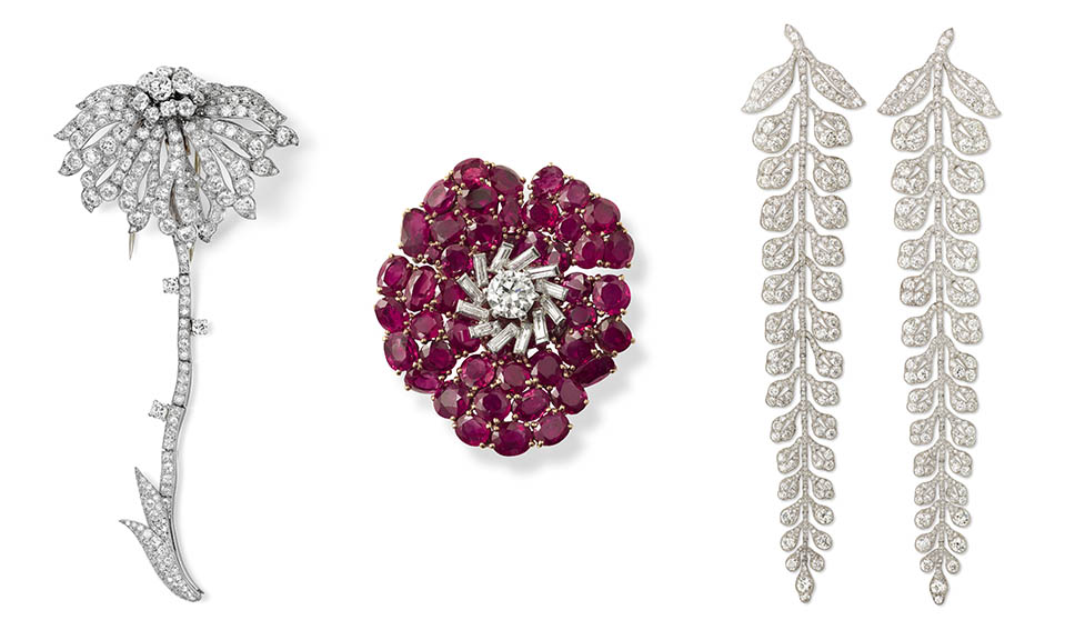 Three Cartier jewels in the 'Jardins' exhibit: Special order diamond and platinum flower clip brooch made in 1941; Ruby, diamond, platinum and gold flower clip brooch made for the Rothschild family in 1938; Two diamond and platinum fern spray brooches made in 1903 for Edward Cassel. Photo Nils Herrmann, Cartier Collection © Cartier