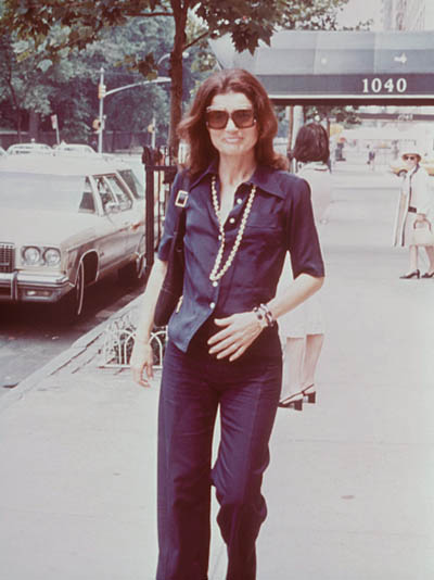 Jacqueline Kennedy Onassis wearing her Cartier Tank watch as she walks in front of her Fifth Avenue apartment building in New York City in the early 1970s Photo Getty