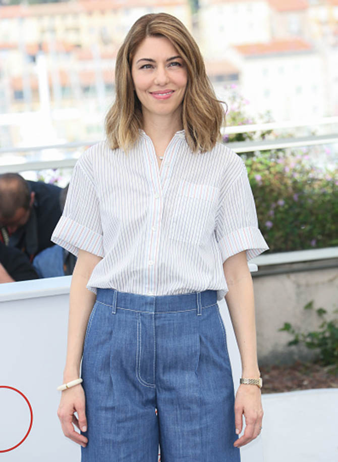 "CANNES, FRANCE - MAY 24: Sofia Coppola in a Cartier Panthere watch, diamond solitaire necklace at the ""The Beguiled"" Photocall during the 70th annual Cannes Film Festival at Palais des Festivals on May 24, 2017 in Cannes, France. (Photo by Tony Barson/FilmMagic)"