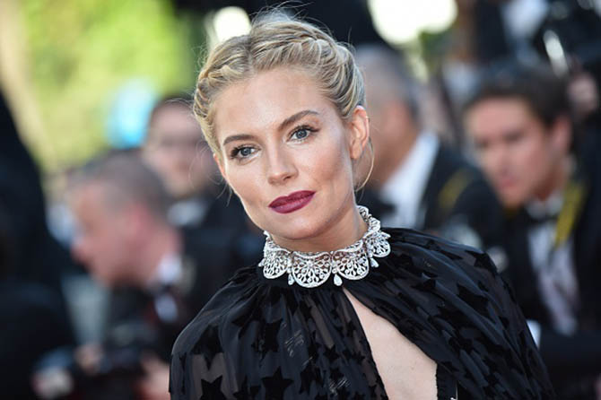 "British actress and member of the Feature Film jury Sienna Miller poses as she arrives for the screening of the film ""Carol"" at the 68th Cannes Film Festival in Cannes, southeastern France, on May 17, 2015. AFP PHOTO / BERTRAND LANGLOIS (Photo credit should read BERTRAND LANGLOIS/AFP/Getty Images)"