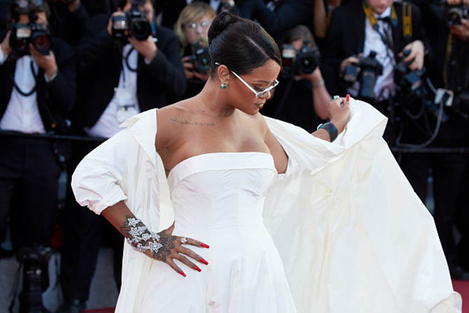 Rihanna wearing a Dior gown and coat with Chopard jewels at the 2017 Cannes Film Festival