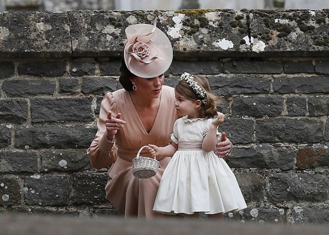 Britain's Catherine, Duchess of Cambridge (L) speaks to her daughter Britain's princess Charlotte, a bridesmaid, following the wedding of her sister Pippa Middleton to James Matthews at St Mark's Church in Englefield, west of London, on May 20, 2017. After turning heads at her sister Kate's wedding to Prince William, Pippa Middleton graduated from bridesmaid to bride on Saturday at a star-studded wedding in an English country church. The 33-year-old married financier James Matthews, 41, at a ceremony attended by the royal couple and tennis star Roger Federer, wearing a couture dress by British designer Giles Deacon. / AFP PHOTO / POOL / KIRSTY WIGGLESWORTH (Photo credit should read KIRSTY WIGGLESWORTH/AFP/Getty Images)