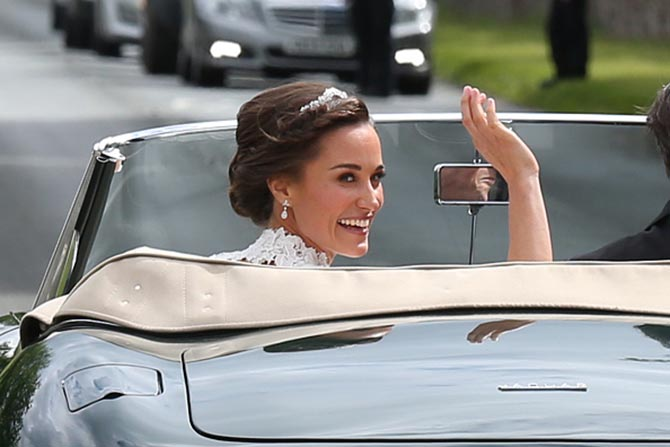 Pippa Middleton in a tiara and diamond earrings by Robinson Pelham driving away from the church with her new husband after her wedding ceremony. Photo Getty