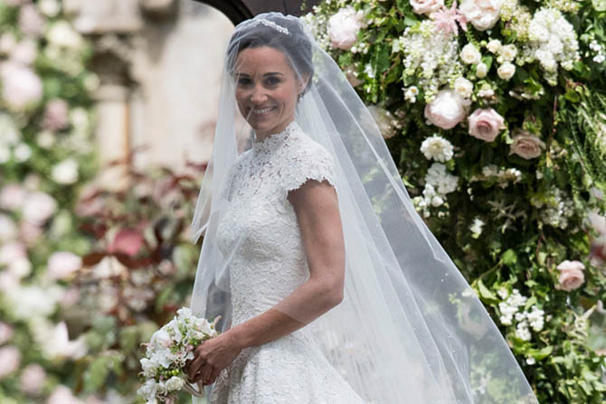 Pippa Middleton arrives to her wedding ceremony in a delicate tiara and diamond earrings by Robinson Pelham. Photo Getty