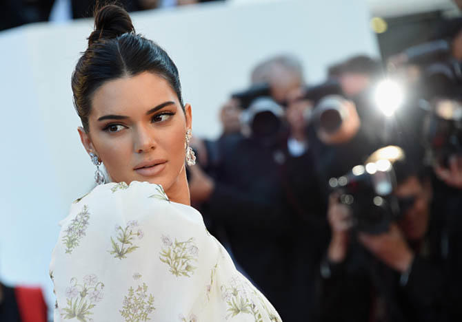 "CANNES, FRANCE - MAY 20: Model Kendall Jenner wearing Chopard earrings attends the ""120 Beats Per Minute (120 Battements Par Minute)"" premiere during the 70th annual Cannes Film Festival at Palais des Festivals on May 20, 2017 in Cannes, France. (Photo by Stephane Cardinale - Corbis/Corbis via Getty Images)"