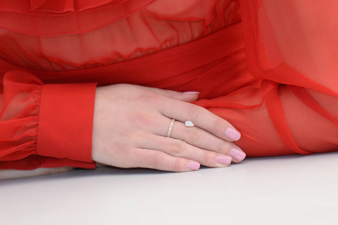 "CANNES, FRANCE - MAY 21: Actress Stacy Martin (detail) of her Repossi ring at the ""Redoubtable (Le Redoutable)"" photocall during the 70th annual Cannes Film Festival at Palais des Festivals on May 21, 2017 in Cannes, France. (Photo by Stephane Cardinale - Corbis/Corbis via Getty Images)"