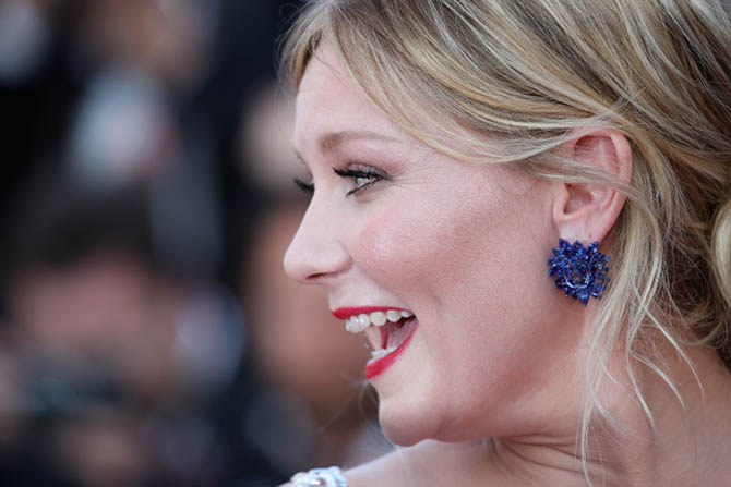 """CANNES, FRANCE - MAY 24: Kirsten Dunst in Chopard earrings at the """"The Beguiled"""" screening during the 70th annual Cannes Film Festival at Palais des Festivals on May 24, 2017 in Cannes, France. (Photo by Chris Jackson/Getty Images)"""