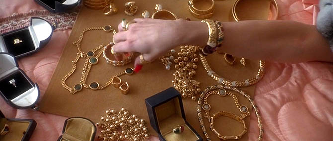 Detail Sharon Stone's hand and the Bulgari jewelry on the bed in 'Casino.' Photo Universal Pictures