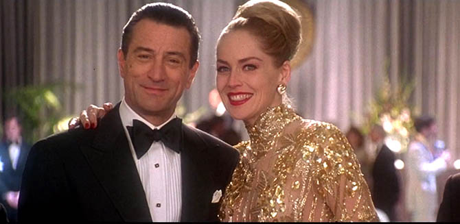 Robert DeNiro with Sharon Stone wearing Bulgari earrings and a beaded gold gown in 'Casino.' Photo Universal Pictures