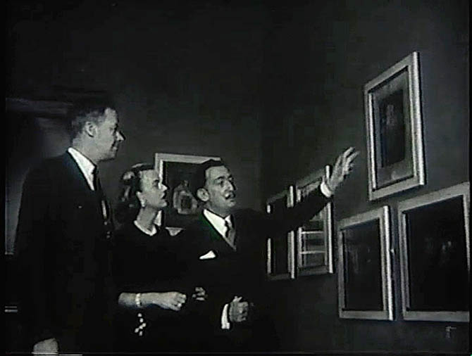Dalí giving a guest and Ellengowan Catherwood a tour of one of his exhibits in 1959. Photo courtesy of Sotheby's