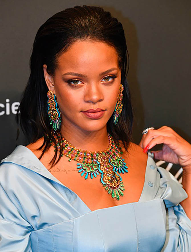 """Barbadian singer Rihanna poses as she arrives for the Chopard """"Space"""" party on the sidelines of the 70th Cannes film festival, on May 19, 2017 in Cannes, southeastern France. / AFP PHOTO / Yann COATSALIOU (Photo credit should read YANN COATSALIOU/AFP/Getty Images)"""