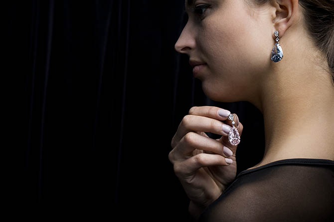 LONDON, ENGLAND - APRIL 10: The Apollo and Artemis Diamonds, the most valuable earrings ever to appear at auction, unveiled today at Sotheby's on April 10, 2017 in London, England. The 14.54-carat Fancy Vivid Blue diamond and the 16-carat Fancy Intense Pink diamond will be offered as individual lots with a combined estimate of $50 million - $70 million at the Magnificent Jewels and Nobel Jewels sale in Geneva on 16th May 2017. (Photo by Tristan Fewings/Getty Images for Sotheby's)