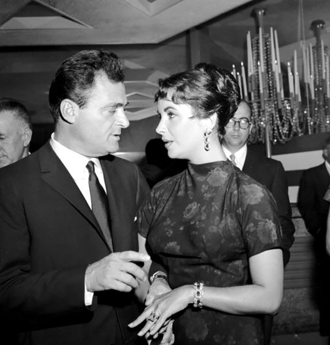 LOS ANGELES - SEPTEMBER 6: Actress Elizabeth Taylor attends singer Gisele MacKenzie's party with her third husband movie producer Mike Todd on September 6, 1957 in Los Angeles, California. (Photo by Michael Ochs Archives/Getty Images)