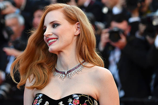 Jessica Chastain who is a member of the Feature Film jury in Piaget's ruby and diamond Sun on Fire Necklace with a 5-carat pear shape diamond at the center.