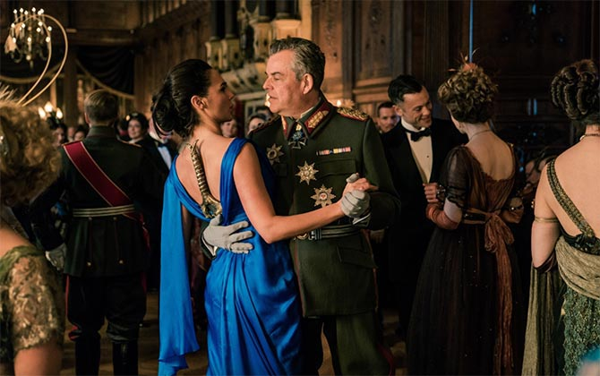 The only scene in 'Wonder Woman' when Diana (Gal Gadot) is not wearing her bracelets. She has her sword down her back while she dances with the enemy Ludendorff (Danny Houston). Photo Warner Brothers