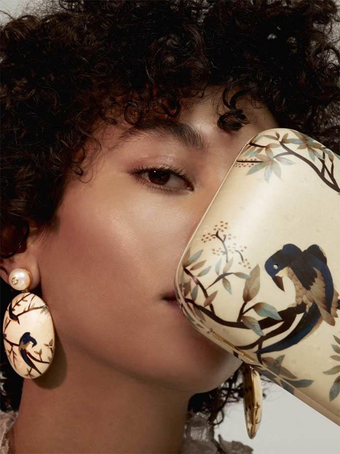 A model posing with earrings and a bag by designer Silvia Furmanovich Photo courtesy of Moda Operandi
