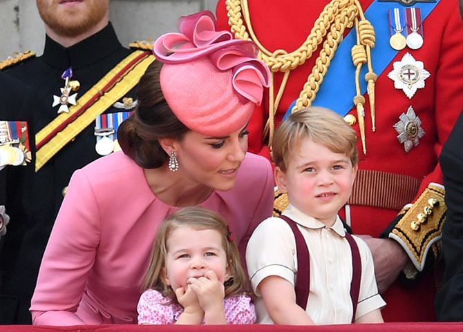 At the June 17, 2017, Trooping of the Colors, on the balcony at Buckingham Palace, Catherine, Duchess of Cambridge, wearing the Queen's antique diamond pendant earrings with Princess Charlotte and Prince George. Photo by Karwai Tang/WireImage