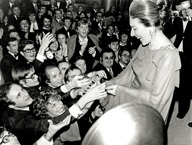 Adoring fans surrounding Maria Callas on her final tour in 1973 wearing her ruby and diamond Van Cleef & Arpels brooch. Photo from 'Maria by Callas' published by Assouline @AGIP/ArchiviFarabola