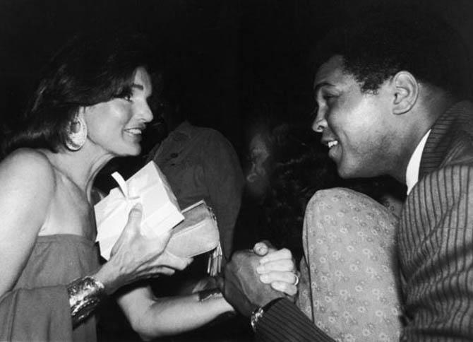 Muhammad Ali with Jackie Kennedy who is wearing her gold Van Cleef & Aprels cuffs with matching earrings at an event in 1977. Photo UPI/The LIFE Images Collection/Getty