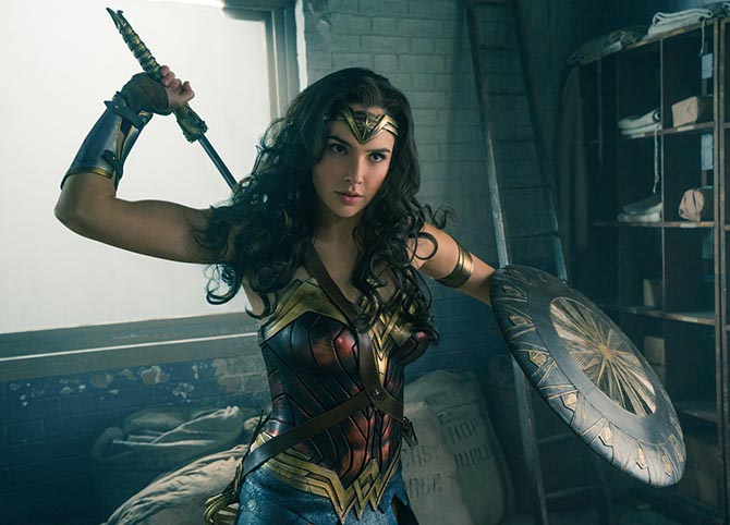 Wonder Woman with all her accessories: the sword, bracelets, bandeau tiara, armband, shield and lasso. Photo Warner Brothers