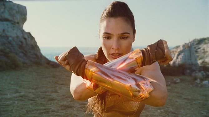 The first time Wonder Woman realizes that when she clashes her bracelets together they produce a concussive forcefield around her. Photo Warner Brothers