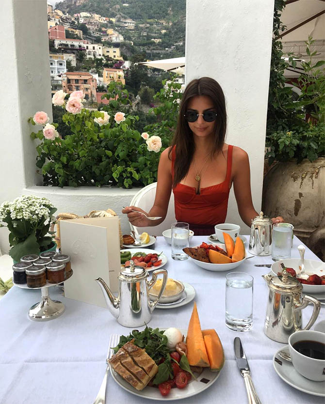Emily Ratajkowski enjoying breakfast on vacation in Italy in her Jennifer Meyer Good Luck Charm Necklace and Jacquie Aiche body chain