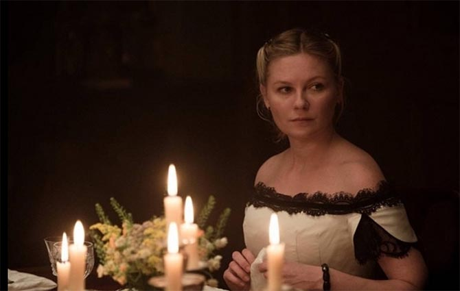 Kirsten Dunst wearing an onyx bracelet and earrings in 'The Beguiled.' Photo Focus Features