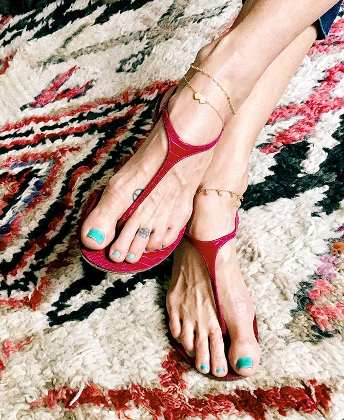 Me & Ro designer Robin Renzi wearing two gold anklets from her collection and one custom gold bead piece. Photo Robin Renzi