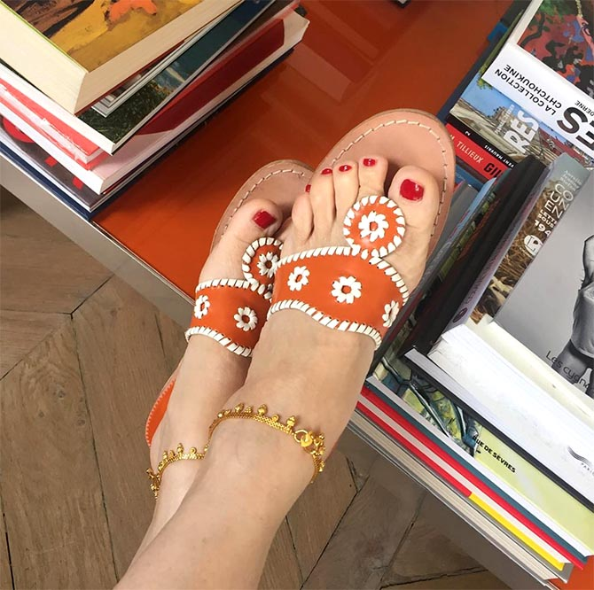 A pair of gold Indian style bracelets paired with classic Jack Rogers sandals on Victoire de de Castellane. Photo @victoiredecastellane/Instagram