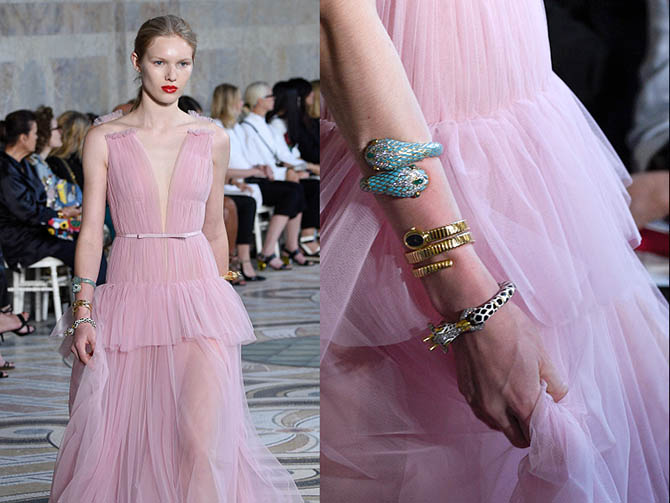 Three vintage bracelets from Eleuteri were piled up the arm of a model in a millennial pink Giambattista Valli dress. The pieces included a 1970s gold, black and white enamel giraffe, a Bulgari tubogas watch-bracelet and a bold Italian two headed bypass bracelet of enamel, diamonds and gems. Photo Getty