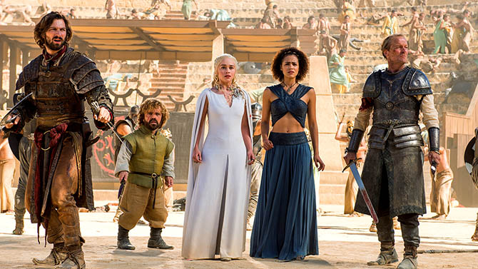 A scene from Season 5 of 'Game of Thrones,' cast members surround Emila Clarke's Daenerys Targaryen, Mother of Dragons who is wearing a necklace carved by Yunus & Eliza Photo HBO