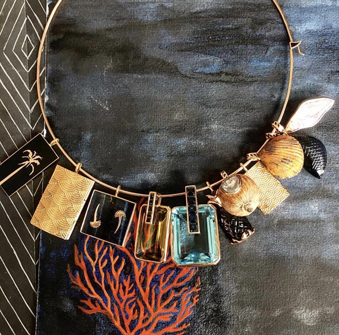 Neckwire with gold and gemset charms from Dezo by Sara Beltran. Photo courtesy