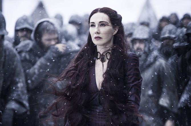 In 'Game of Thrones' The Red Priestess Melisandre remains young and beautiful thanks to magical red choker necklace which she never takes off. Photo HBO