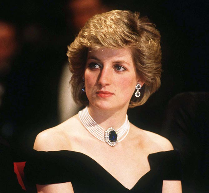 Diana wearing her double drop sapphire and diamond earrings and sapphire and pearl choker in October, 1986. Photo by Anwar Hussein/WireImage