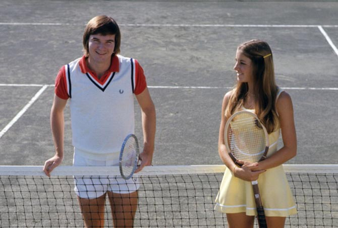 Jimmy Connors poses on the court with Chris Evert in 1974. Photo Getty