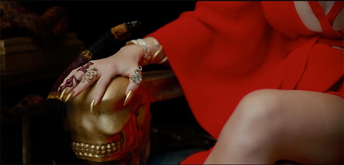 "Detail of Taylor Swift's hand covered in snake rings from Lydia Courteille, Borgioni and Gilan in her ""Look What You Made Me Do"" video."