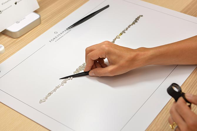 Jade Trau's column of rough diamonds sorted from colorless to dark diamonds in Forevermark's Master Class. Photo by Andrew Werner